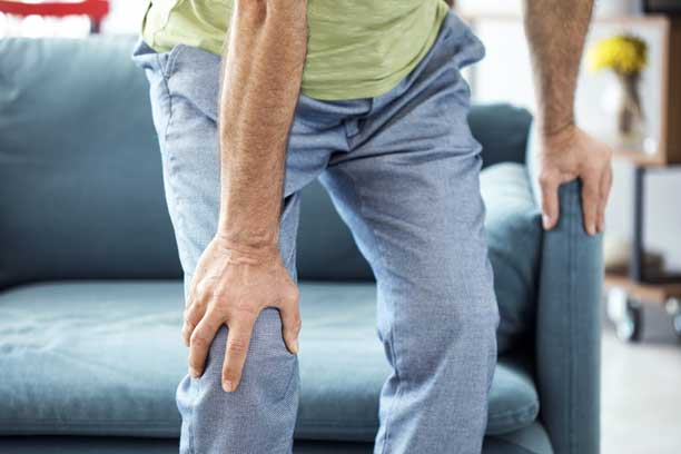 Man Suffering From Knee Pain — Fort Myers, FL — Southwest Florida Neurosurgical Associates